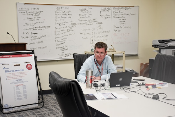 James Buhr, U.S. Army Engineering and Support Center, Huntsville project manager and Emergency Operations Center team member, listens during the U.S. Army Corps of Engineers daily commander's telecon briefing March 25.