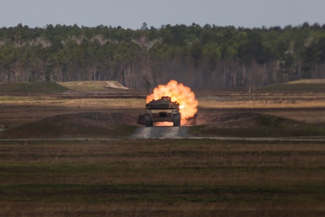 U.S. Marine Corps Cpl. Juan Martinez, a tank crewman with 2d Tank Battalion (2nd Tanks), 2d Marine Division (MARDIV), fires an M1A1 Abrams tank from the main gun during a live-fire exercise at Camp Lejeune, North Carolina, March 20, 2020.