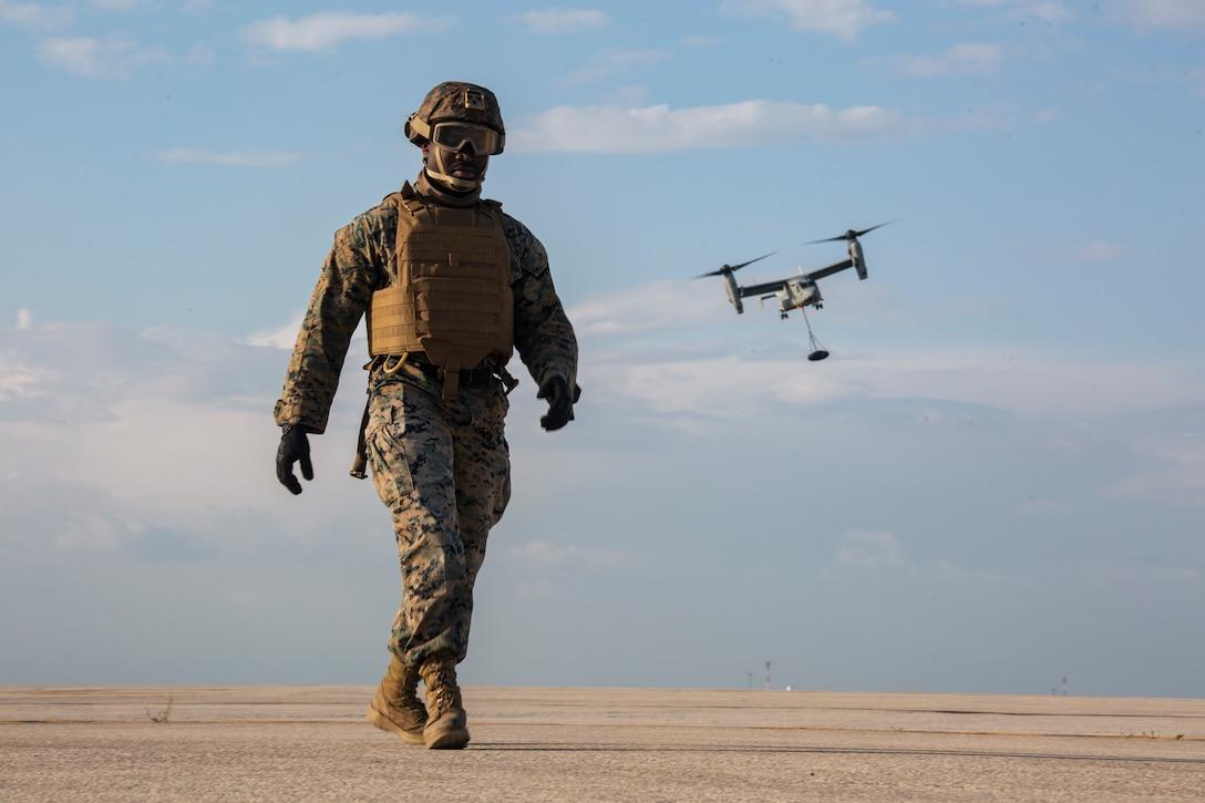 Marine walks off the flightline during external lift training at Morón Air Base, Spain, March 25.