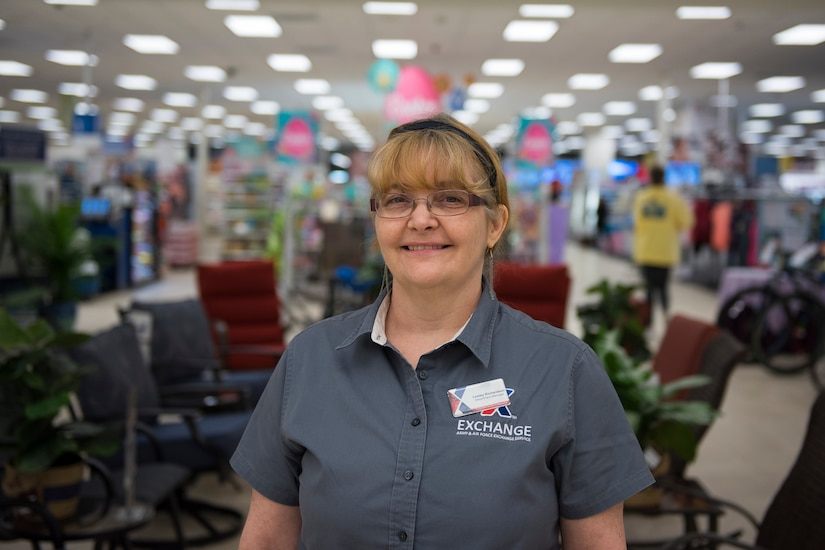 Lesley Richardson, a department manager for the Base Exchange main store, poses for a photo in the Exchange on Joint Base Charleston, S.C., March 23, 2020.
