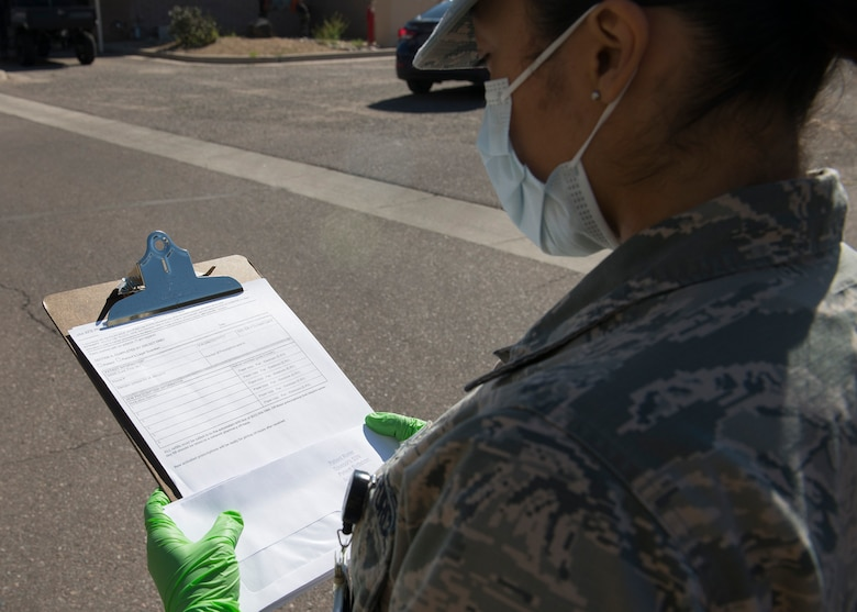 Airman 1st Class Erika Tolentino, 56th Medical Group pharmacy technician, prepares to fill a prescription activation form March 26, 2020, at Luke Air Force Base, Ariz.