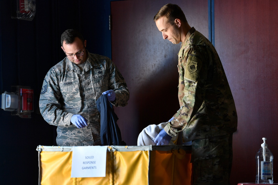 Master Sgt. Albert Stoner, 3rd Space Experimentation Squadron operations superintendent and noncommissioned officer in charge of the Rapid Response Decontamination Detail, and Capt. James Selix, 3rd SES weapons officer and officer in charge of R2D2, set up new operations facilities for R2D2 at the base fitness center at Schriever Air Force Base, Colorado, March 27, 2020.  The mission of the team is to decontaminate any location affected by COVID-19. (U.S. Air Force photo by Dennis Rogers)