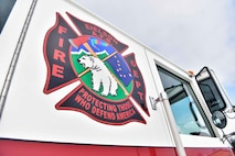 The 354th Civil Engineer Squadron fire department emblem on the side of a firetruck on Eielson Air Force Base, Alaska, March 26, 2020. Eielson firefighters respond to different types of calls including fire and medical emergencies, accidents involving hazardous materials and incidents on the flight line. (U.S. Air Force photo by Senior Airman Beaux Hebert)