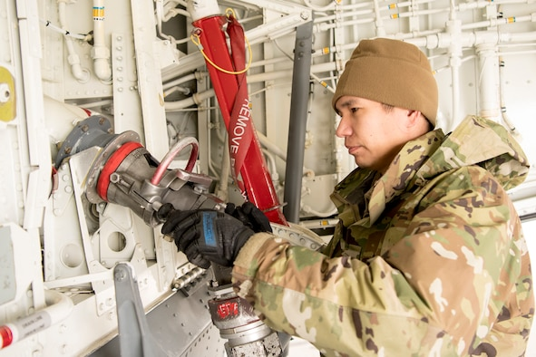 Tech. Sgt. David Taylor, 434th Aircraft Maintenance Squadron crew chief, fuels a KC-135R Stratotanker at Grissom Air Reserve Base, Indiana March 20, 2020. The tanker along with three other tankers are preparing to deploy to Southwest Asia in support of Air Force Central Command combat operations. (U.S. Air Force photo/Master Sgt. Ben Mota)