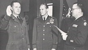 Brig. Gen. Joseph F. Carroll (left) being sworn in as OSI's first Commander, as Chief of Staff of the Air Force Hoyt S. Vandenberg (center) witnesses the swearing in. (U.S. Air Force photo).