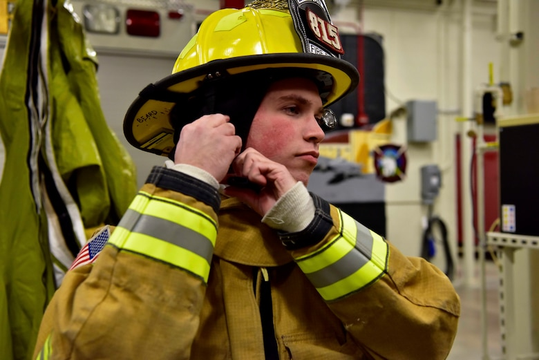 Airman 1st Class Taylor Beard, a 354th Civil Engineer Squadron firefighter, dons fire protection equipment during a training exercise on Eielson Air Force Base, Alaska, March 26, 2020. Eielson firefighters wear approximately 40 lbs. of gear when responding to a fire, their training involves donning the gear within 60 seconds to cut down their response time when they are called to an emergency situation. (U.S. Air Force photo by Senior Airman Beaux Hebert)
