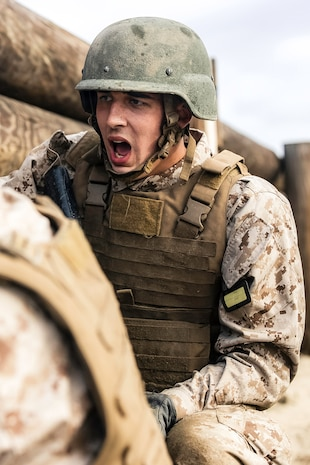 A recruit with Golf Company, 2nd Recruit Training Battalion responds to a drill instructor during the Bayonet Assault course at Marine Corps Recruit Depot, San Diego, March 24, 2020.