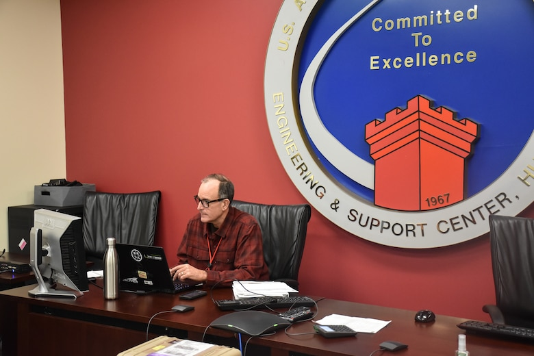 Bill Ferguson, U.S. Army Engineering and Support Center, Huntsville Emergency Operations Center operations chief, prepares notes for the U.S. Army Corps of Engineers daily commander's telecon briefing March 25.