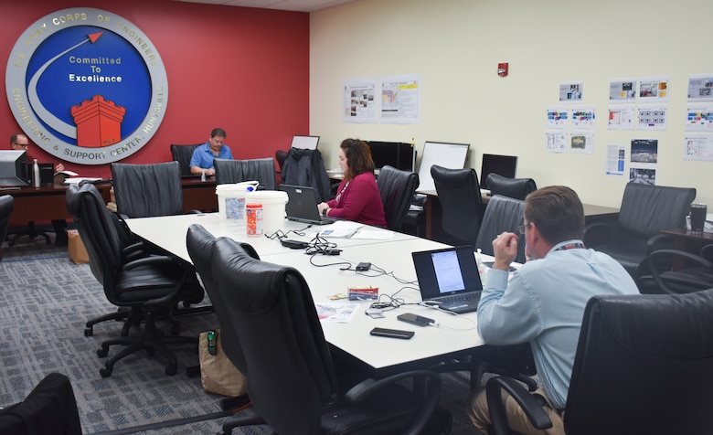 U.S. Army Engineering and Support Center, Huntsville Emergency Operations Center staff observe social distancing during operations at the Huntsville Center headquarters March 25.