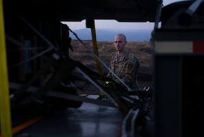 Airman 1st Class Timothy Skelton, 374th Logistics Readiness Squadron vehicle operator, anchors bundles onto a trailer