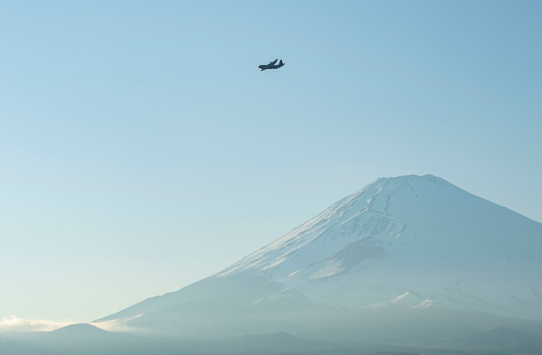 A C-130J Super Hercules assigned to the 36th Airlift Squadron, Yokota Air Base, Japan, flies over the Combined Arms Training Center, Camp Fuji, Japan