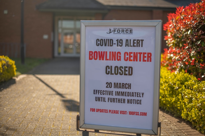 "A ""closed"" sign is posted outside the bowling center at RAF Mildenhall, England, March 25, 2020. Base services have been reduced and extra precautions put in place to help prevent the spread of COVID-19. (U.S. Air Force photo by Staff Sgt. Luke Milano)"