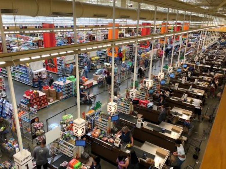 Commissary staff in Jacksonville, Florida, serve customers while praticing social distancing.