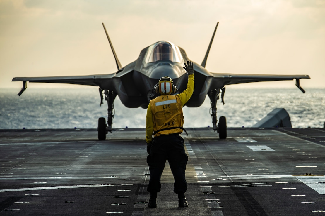 An F-35B Lightning II fighter aircraft prepares to take off from the flight deck of  the USS America March, 25.