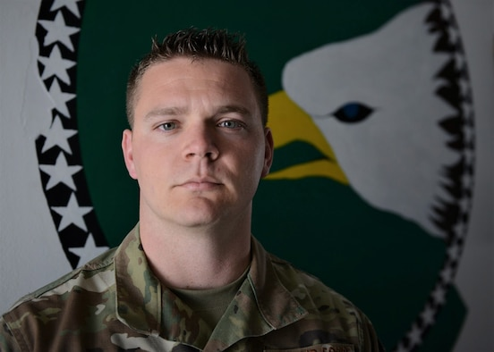 U.S. Air Force Tech. Sgt. Brett Carpenter, 31st AMXS and 555th Aircraft Maintenance Unit F-16 Fighting Falcon aircraft electrical and environmental systems specialist, poses for a photo at Aviano Air Base, Italy, March 25, 2020. Carpenter and his family stay resilient by working out at home, gardening, taking care of their animals and cooking new food dishes. (U.S. Air Force photo by Tech. Sgt. Rebeccah Woodrow)