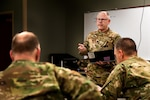 U.S. Air Force Lt. Col. Gary Katz, a flight surgeon assigned to the 178th Wing serving on Joint Task Force-37, briefs commanders March 23, 2020, at the Defense Supply Center in Columbus, Ohio. Katz is one of more than 400 members of the Ohio National Guard supporting food distribution at 12 locations across Ohio serving more than 11 million Ohioans in all 88 counties.