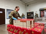Michigan National Guard members support the distribution of food for families in need during the state's response to COVID-19 at the Food Bank of Eastern Michigan, Flint, Mich., March 30, 2020. About 40 Michigan Guard members are helping at four Michigan food banks for several weeks.