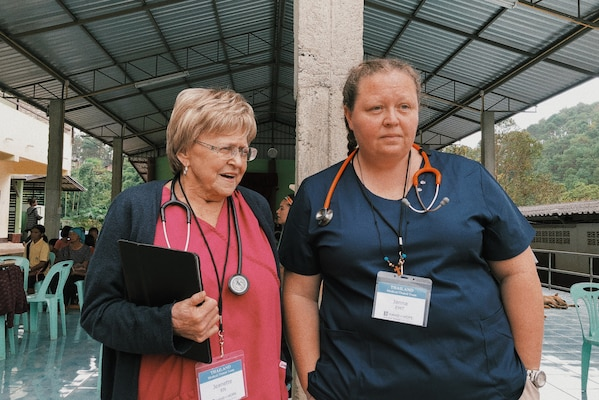 """IMAGE: CHIANG MAI region, Thailand (Nov. 2018) – Naval Surface Warfare Center Dahlgren Division (NSWCDD) Engineering Technician Janna Roland, right, and Registered Nurse Jeanette Wachtler of Alberta, Canada joined a team of 27 medical and dental professionals who served more than 1,600 patients in five days during a mission trip to Thailand through Hand of Hope, Joyce Meyer Ministries World Missions, Oct. 25-Nov. 4, 2018. Roland received the NSWCDD Distinguished Community Service Award in 2019 for """"outstanding contributions to the community"""" for participating in the trip as well as serving more than 16 years as an EMT for the Chancellor Volunteer Fire and Rescue Department, which serves parts of Spotsylvania County, Va. """"Roland selflessly shares her extensive expertise to help those in the local community and abroad,"""" cites the award. (U.S. Navy photo/Released)"""