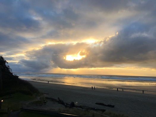 Sunshine peers through gloomy clouds, bringing rays of hope to Cannon Beach, Ore. February 23, 2019. (Courtesy photo by Emily Moon)