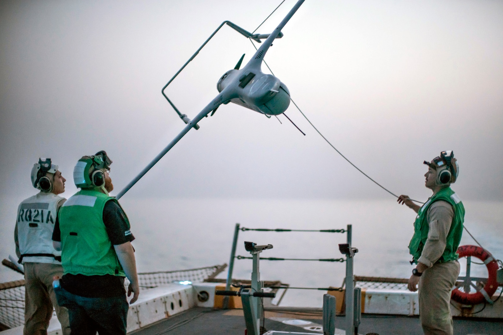 Marines lower RQ-21A Blackjack unmanned aerial system from recovery system aboard USS John P. Murtha, Gulf of Aden, July 2019 (U.S. Marine Corps/Adam Dublinske)