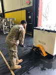 Soldiers from the 103rd Engineer Battalion, Pennsylvania National Guard, help the Federal Emergency Management Agency unload equipment at the a school in Glen Mills, Pa., to establish a federal medical station for non-COVID 19 patients should regional hospitals become full.