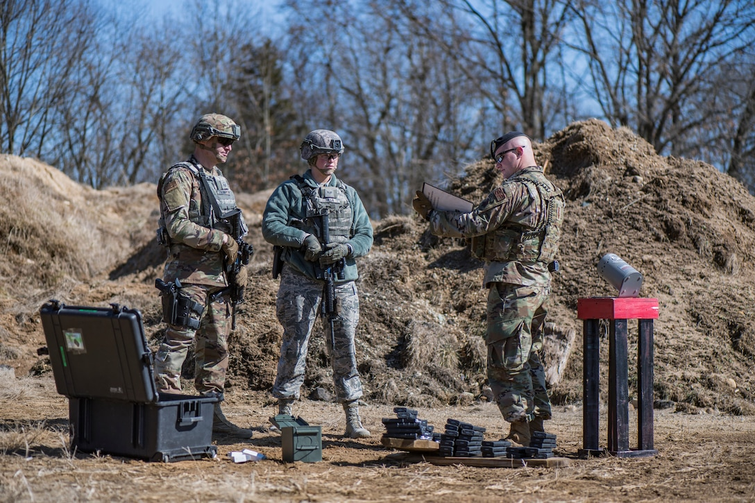 """Members of the 110th Security Forces Squadron train during """"Shoot, Move, and Communicate"""" drills"""