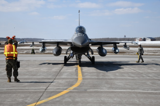 Aircraft maintenance personnel from the 148th Fighter Wing recover a Block 50CM F-16 Fighting Falcon upon its' return from an Operation NOBLE EAGLE deployment.