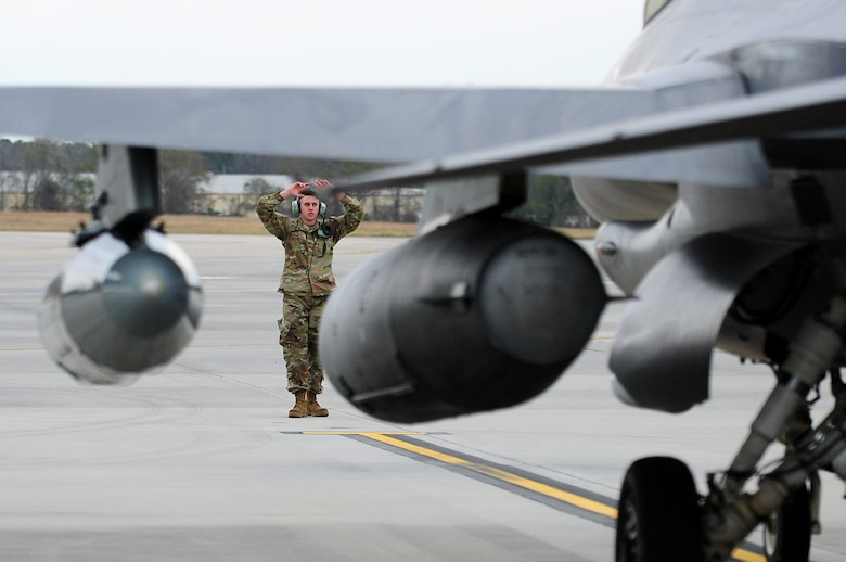 A crew chief from the 148th Fighter Wing recovers a Block 50, F-16 while deployed in support of a NORAD tasked Operation NOBLE EAGLE mission