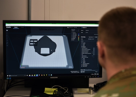 U.S. Air Force Tech. Sgt. Tracy Gibbs, 312th Training Squadron Special Instruments Training course graduate, prepares a 3D printed N95 face mask to be printed through modeling software at the Louis F Garland Department of Defense Fire Academy on Goodfellow Air Force Base, Texas, March 31, 2020. In an effort to help protect those caring for sick individuals around the world, a neurosurgeon in Billings, Montana, made a model available online for a free 3D printable, high-efficiency filtration mask with a design that allows reuse of the mask. (U.S. Air Force photo by Airman 1st Class Robyn Hunsinger)