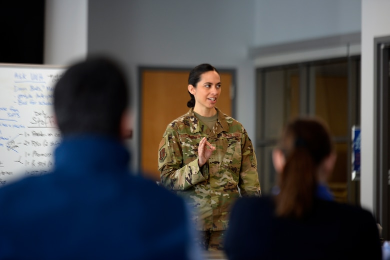 "Maj. Michelle Mastrobattista, administration officer for the 157th Medical Group, New Hampshire Air National Guard, discusses with regional hospital representatives the operations scope of the additional care site at the Hamel Recreation Center, University of New Hampshire on March 26. The facility in Durham will augment area hospitals treating COVID-19 cases, if necessary. It is one of nine ""surge"" locations the NH Guard, in coordination with local and state healthcare agencies, plans to set up and manage across the state. (U.S. Air National Guard photo by Tech. Sgt. Aaron Vezeau)"