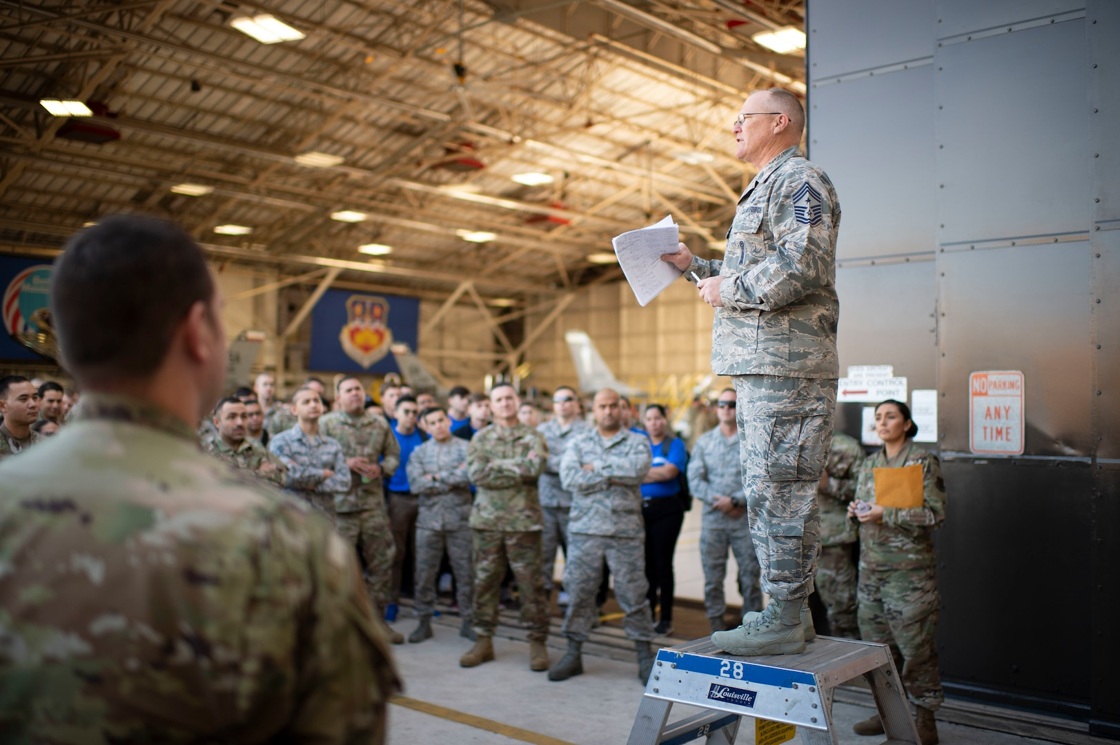 Chief Master Sergeant Darin LaCour, 149th Fighter Wing command chief, speaks to enlisted Airmen of importance of professional military education, at Joint Base San Antonio–Lackland, Texas, November 2, 2019 (Air National Guard/Derek Davis)