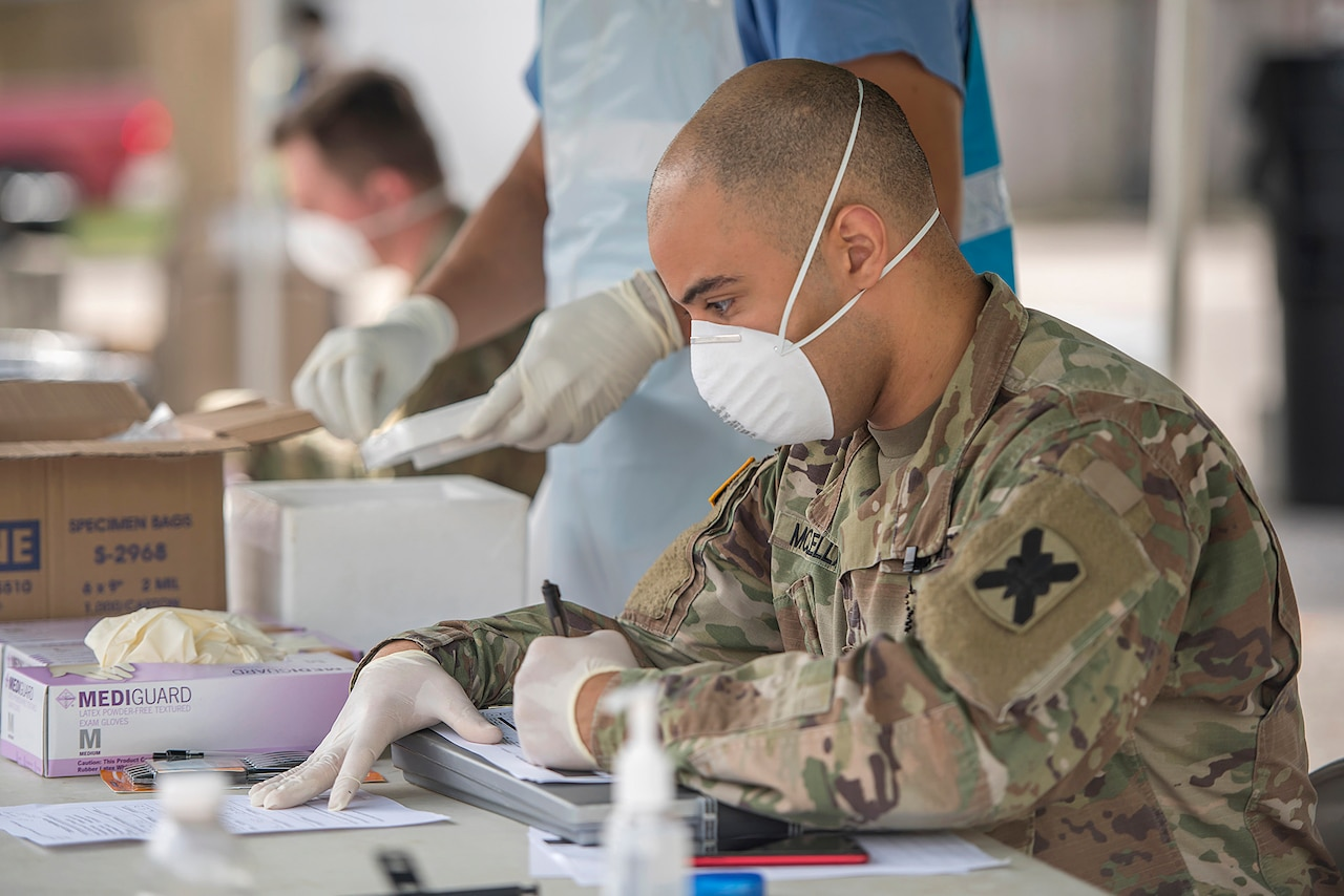 Masked soldier processes swabs.