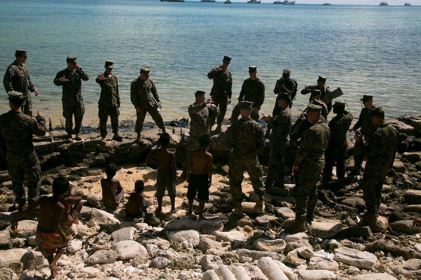 Platoon commander with 2nd Battalion, 8th Marine Regiment, gives professional military education class explaining strategy the Marines of 2/8 used when they landed on Red Beach 3 in November 1943, Betio, Kiribati, July 22, 2018 (U.S. Marine Corps/Timothy Hernandez)
