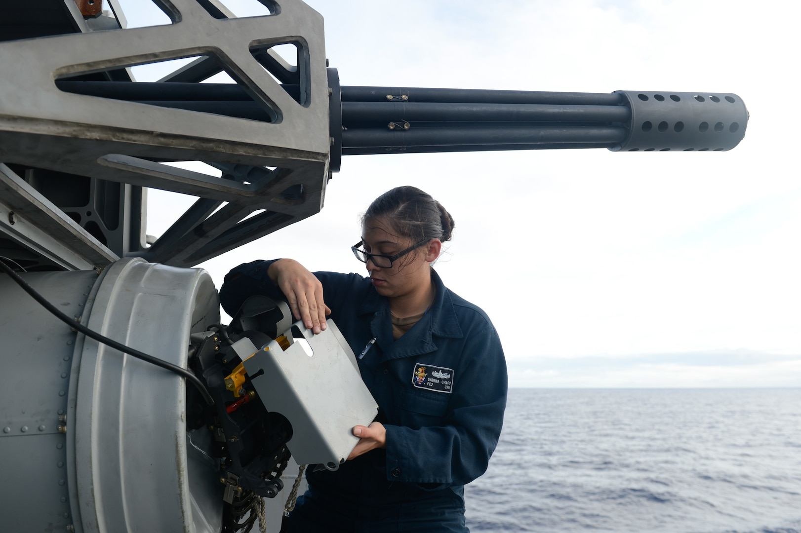 Fire controlman installs radiation cover onto Phalanx close-in weapon system