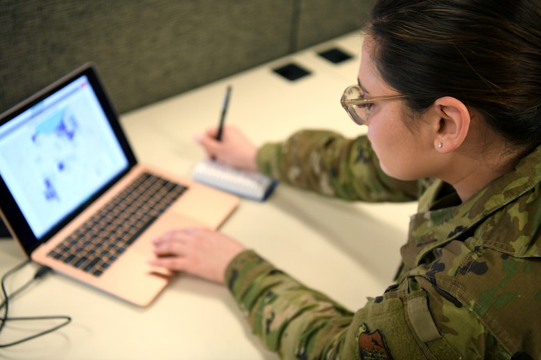 Senior Airman Elise, an analyst assigned to the 178th Wing, analyzes a map of counties throughout Ohio March 30, 2020, at the Defense Supply Center Columbus. Elise is serving on the Joint Task Force 37 collecting data on coronavirus cases, hospitalizations and available hospital resources across the state, as well as providing weather and route information for the JTF-37 task forces supporting local food banks.