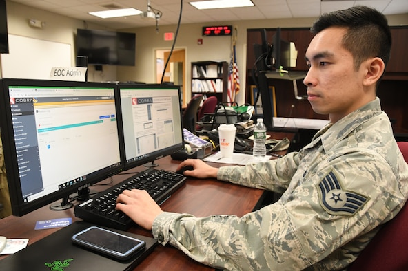 Staff Sgt. Tran Thinh, 104th Fighter Wing Emergency Management, monitors and coordinates with the Emergency Operation Center on critical information requests in response to COVID-19, March 30, 2020. Trinh serves in his community as an Air National Guard member and is an engineering student at the University of Connecticut. (U.S. Air National Guard Photo by Senior Master Sgt. Julie Avey)