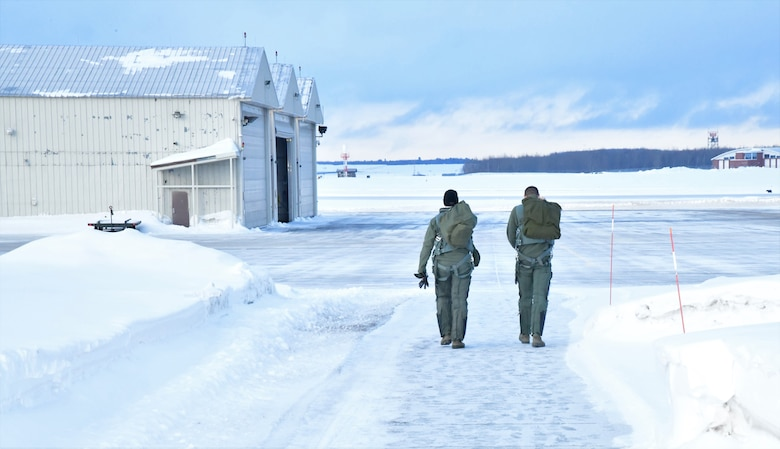 148th Fighter Wing pilots walk to their jets before taking off to support a NORAD tasked Operation NOBLE EAGLE deployment.