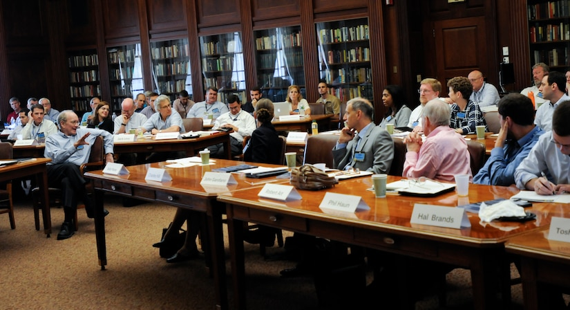 John Lewis Gaddis, front left, Robert A. Lovett Professor of Military and Naval History at Yale University, speaks to U.S. Naval War College faculty during Teaching Grand Strategy workshop, in Newport, Rhode Island, August 16, 2012 (U.S. Navy/Eric Dietrich)