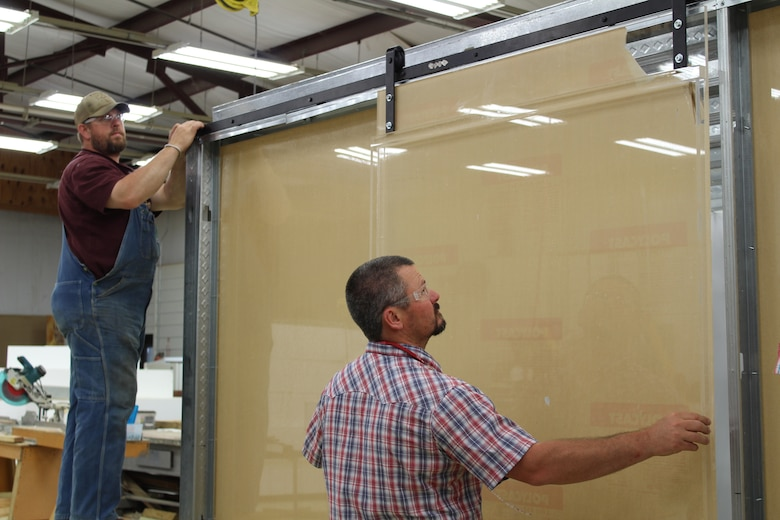 ERDC's Directorate of Public Works staff work to build two types of mock-up hospital rooms.