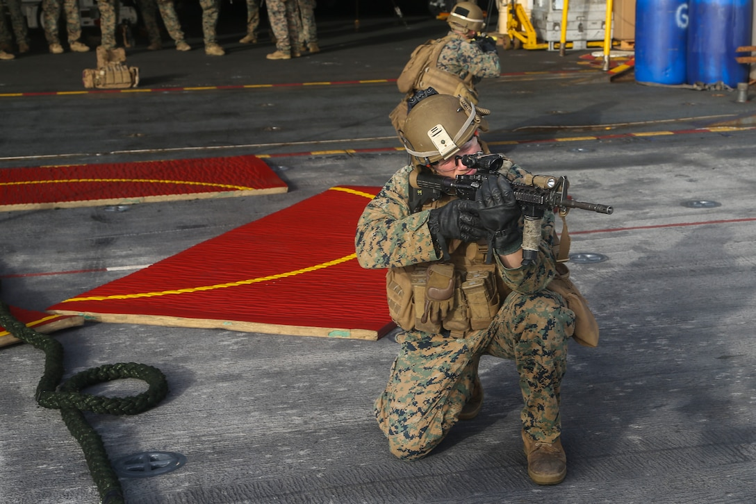 200429-M-KE756-1061 U.S. 5TH FLEET AREA OF OPERATIONS (April 29, 2020) Lance Cpl. Jeffrey Gannon, rifleman, assigned to Fox Company, Battalion Landing Team 2/8, 26th Marine Expeditionary Unit (MEU), provides security after fast-roping from an MV-22B Osprey aboard the amphibious assault ship USS Bataan (LHD 5) April 29, 2020. Bataan, with embarked 26th MEU, is deployed to the U.S. 5th Fleet area of operations in support of naval operations to ensure maritime stability and security in the Central Region, connecting the Mediterranean and Pacific through the Western Indian Ocean and three strategic choke points. (U.S. Marine Corps photo by Cpl. Tanner Seims)