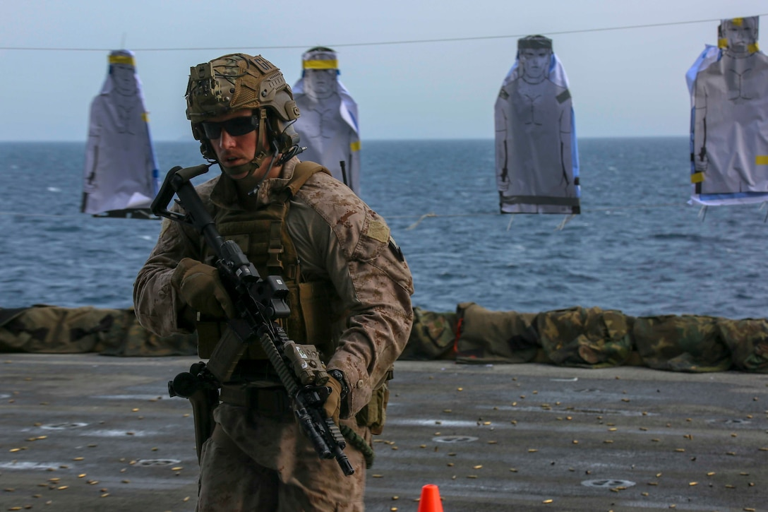 200430-M-IR130-1480 U.S. 5TH FLEET AREA OF OPERATIONS (April 30, 2020) A Marine assigned to the Maritime Raid Force, 26th Marine Expeditionary Unit (MEU), changes positions during a live-fire training range aboard the amphibious assault ship USS Bataan (LHD 5) April 30, 2020. Bataan, with embarked 26th MEU, is deployed to the U.S. 5th Fleet area of operations in support of naval operations to ensure maritime stability and security in the Central Region, connecting the Mediterranean and Pacific through the Western Indian Ocean and three strategic choke points. (U.S. Marine Corps photo by Cpl. Gary Jayne III)