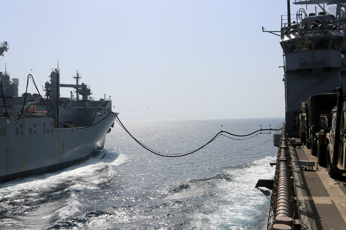 200425-M-CB805-1010 U.S. 5TH FLEET AREA OF OPERATIONS (April 25, 2020) The dry cargo and ammunition ship USNS Robert E. Peary (T-AKE 5), left, refuels the amphibious dock landing ship USS Oak Hill (LSD 51) during a replenishment-at-sea April 25, 2020. Oak Hill, with embarked 26th MEU, is deployed to the U.S. 5th Fleet area of operations in support of naval operations to ensure maritime stability and security in the Central Region, connecting the Mediterranean and Pacific through the Western Indian Ocean and three strategic choke points. (U.S. Marine Corps photo by Staff Sgt. Pablo D. Morrison)