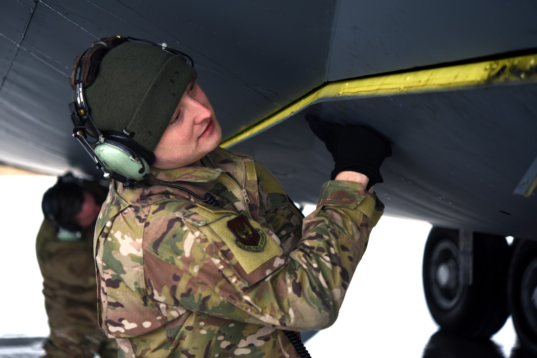 U.S. Air Force Staff Sgt. Shannon Nations, 100th Aircraft Maintenance Squadron flying crew chief, preps a KC-135 Stratotanker from RAF Mildenhall during training with Romanian air force F-16s in Bucharest, Romania, March 12, 2019. The crew was involved in training with Romanian air force F-16s over the skies of Romania, which enhanced regional capabilities to secure air sovereignty and promote peace and security through cooperation, collaboration, interoperability with NATO allies in the region. (U.S. Air Force photo by Airman 1st Class Brandon Esau)