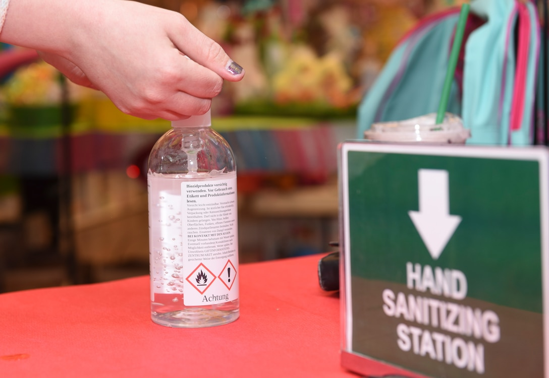 A Ramstein Base Exchange customer uses a hand sanitizing station to prevent the spread of coronavirus disease 2019 at Ramstein Air Base, Germany, April 21, 2020.
