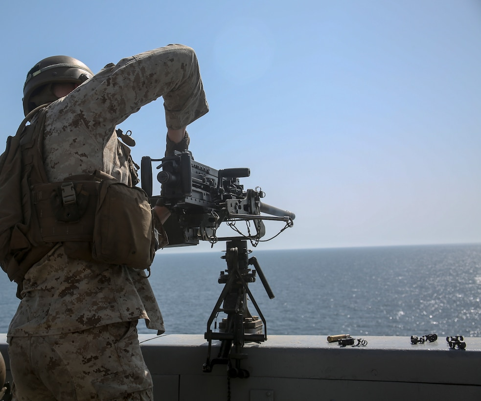 200428-M-MV109-1069 U.S. 5TH FLEET AREA OF OPERATIONS (April 28, 2020) Lance Cpl. Daniel Gress, machine gunner, assigned to Combined Anti-Armor Team, Echo Company, Battalion Landing Team 2/8, 26th Marine Expeditionary Unit (MEU), demonstrates the reloading of an M2 machine gun during a live-fire training range aboard the amphibious transport dock USS New York (LPD 21) April 28, 2020. New York, with embarked 26th MEU, is deployed to the U.S. 5th Fleet area of operations in support of naval operations to ensure maritime stability and security in the Central Region, connecting the Mediterranean and Pacific through the Western Indian Ocean and three strategic choke points. (Marine Corps photo by Staff Sgt. Patricia A. Morris)