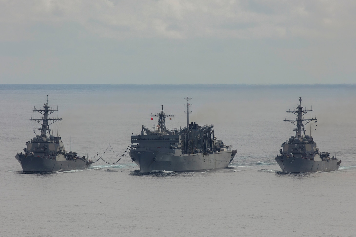 NORTH ATLANTIC (April 28, 2020) - The Arleigh Burke-class guided-missile destroyer USS Donald Cook (DDG 75) and USS Porter (DDG 78) conduct a connected replenishment with the USNS SUPPLY (T-AOE 6)  to receive fuel and stores, April 28, 2020. CNE-CAN/C6F, headquartered in Naples, Italy, oversees joint and naval operations, often in concert with Allied, joint, and interagency partners, in order to advance U.S. national interests and security and stability in Europe and Africa. (Photo by Royal Navy Photograher Dan Rosenbaum/Released)
