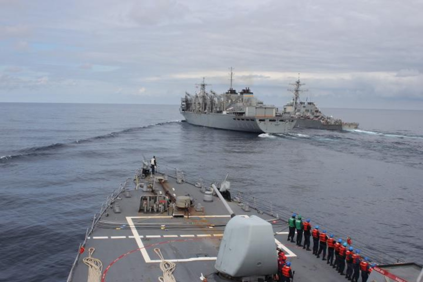 NORTH ATLANTIC (April 28, 2020) - The Arleigh Burke-class guided-missile destroyer USS Donald Cook (DDG 75) makes her approach alongside USNS SUPPLY (T-AOE 6) and USS Porter (DDG 78) for a connected replenishment (CONREP) to receive fuel and stores, April 28, 2020. CNE-CAN/C6F, headquartered in Naples, Italy, oversees joint and naval operations, often in concert with Allied, joint, and interagency partners, in order to advance U.S. national interests and security and stability in Europe and Africa. (U.S. Navy photo by Yeoman Third Class Anthony Nichols/Released)