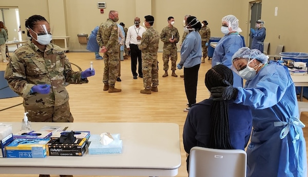 A mobile testing strike team comprised of Georgia Army National Guard Soldiers of the 48th Infantry Brigade Combat Team administer more than 100 Covid 19 tests to the staff of Central State Hospital in Milledgeville, Ga. April 21, 2020. Nine mobile testing teams are currently fielded across the state while Guard personnel are supporting Ga. Department of Public Health at 20 of 36 specimen control points statewide. (Capt. Fred Dablemont)