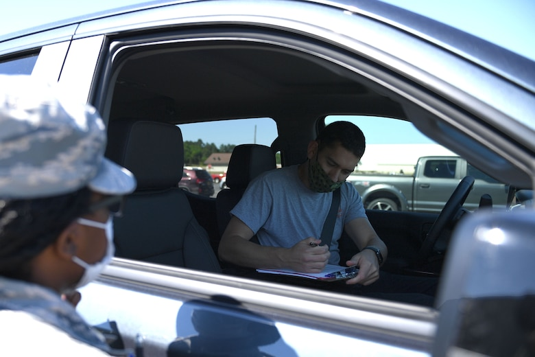 A man signs a paper
