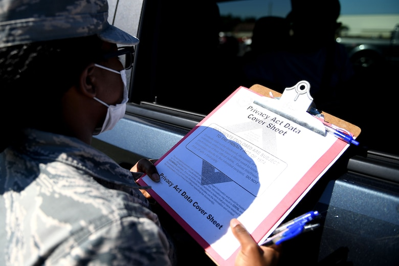 a paper is being shown.